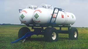 M-2200 shown with 16.5L x  16.1 tires, double 1000 gallon tanks, decals, water bottles, and optional ladders.