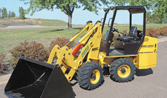 Easy operating NMC 2850 articulated loader features high visibility cab with wheel steering (no directional levers).